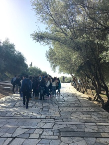 group of Greek students learning about Greek history in Greece. what pride in your heritage and homeland that must instill. too bad as a black American I'll never know what that's like.